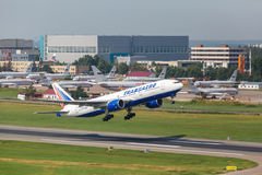 Boeing 777 take off from runway Stock Image
