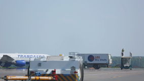 Boeing 777 taxiing on apron to the parking lot after landing stock footage