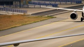 Boeing 777 taxiing after landing. Frankfurt Am Main, Germany - July 18, 2017: Boeing 777 Lufthansa Cargo, taxiing after landing at 07L. Fraport, Frankfurt stock video