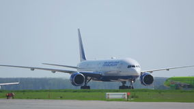 Boeing 777 taxiing on runway to the parking lot after landing stock video footage