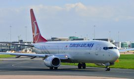 Boeing 737 taxiing. Turkish Airlines Boeing 737 taxiing at Manchester Airport stock photos