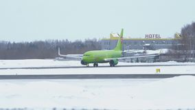 Boeing 737-800 taxis to runway at Tolmachevo Airport in winter stock video