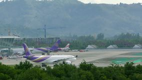 Boeing 767 of Thai Airlines turns on taxiway in airport stock video footage