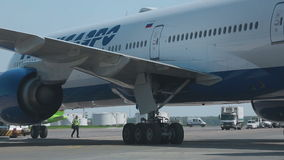 Boeing 777 towed to the parking lot stock video
