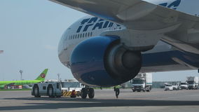 Boeing 777 towed to the parking lot stock footage