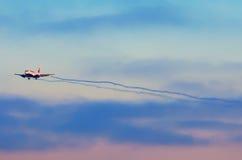 Boeing-737 Transaero, airport Pulkovo, Russia Saint-Peterburg 06 January 2015 Airplane sky sunset cloud vortexes Stock Photos