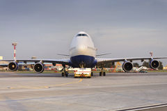 Boeing 747 Transaero towed to the runway. Stock Photos