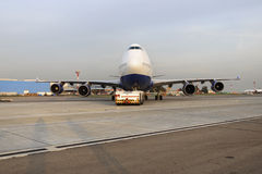 Boeing 747 Transaero towed to the runway. Royalty Free Stock Image