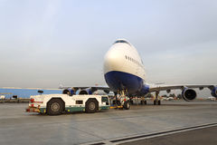 Boeing 747 Transaero towed to the runway. Royalty Free Stock Photography