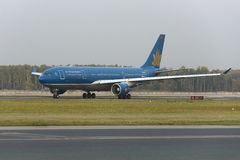 Boeing 777 Vietnam Airlines taxiing. MOSCOW, RUSSIA - SEPTEMBER 26, 2014: Boeing 777 Vietnam Airlines taxiing after landing at Domodedovo International airport stock photos