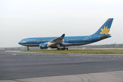 Boeing 777 Vietnam Airlines taxiing. MOSCOW, RUSSIA - SEPTEMBER 26, 2014: Boeing 777 Vietnam Airlines taxiing after landing at Domodedovo International airport royalty free stock images