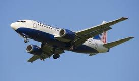 Boeing 737-5Y0 (EI-DTW) to Transaero in flight closeup Stock Photos