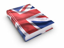Boek dat met Britse vlag wordt behandeld Stock Foto's