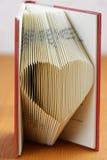 Boek die hart vouwen royalty-vrije stock foto