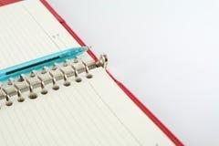 Boek en pen Royalty-vrije Stock Afbeeldingen