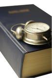 Boek met klok Stock Foto
