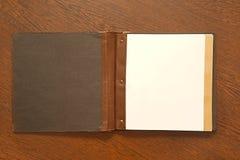 Boek op een bureau Stock Afbeeldingen
