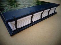 Boekbindennotitieboekje stock foto