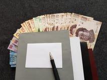 boeken en Mexicaanse rekeningen in verschillende benamingen Stock Afbeelding
