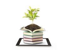Boeken en tabletcomputer Stock Foto's