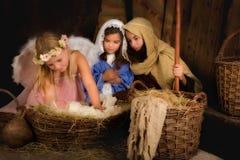 Bożenarodzeniowa narodzenie jezusa scena z aniołem Zdjęcia Royalty Free