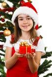 Bożenarodzeniowy czas - dziewczyna z Święty Mikołaj kapeluszem Zdjęcia Royalty Free