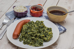 Boerenkool with smoked sausage on a white plate Royalty Free Stock Photo