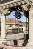 Boersch (Alsace) - Well. Boersch (Bas-Rhin, Alsace, France) - Old well with pulleys and wooden buckets royalty free stock photo