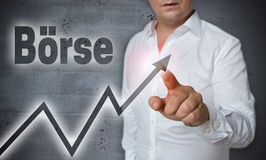 Boerse (in german stock market) touchscreen is operated by man Royalty Free Stock Photography