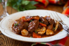 Boeuf Bourguignon. With carrots,onions and mushrooms Stock Photo