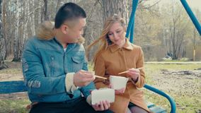 Bofriend Teaching Girlfriend How to Eat with Sticks stock footage