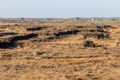 Bog with Farm houses in background. Clifden, Galway, Conemara, Ireland stock photography