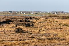 Bog with Farm houses in background. Clifden, Galway, Conemara, Ireland royalty free stock image