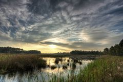 Bog Landscape. Sunset (sunrise) over bog lake (HDR image). Photo taken near Wlodawa city (Eastern Poland Stock Photo
