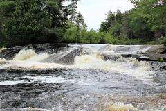 Bog River Falls. Scenic landscape and flow in Tupper Lake, New York in the Adirondacks, designated as Scenic River by the State of New York royalty free stock photos