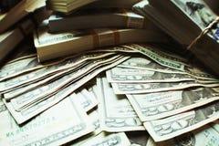 Bogactwo Akcyjna fotografia Z stertami pieniądze obraz stock