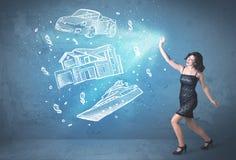 Bogatej osoby miotania ręka rysujący samochodowy dom i jacht Fotografia Stock