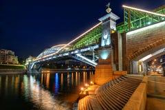 Bogdan Khmelnitsky bridge at night in Moscow. Bogdan Khmelnitsky bridge at night on august 20, 2013 in Moscow. It is a beautiful pedestrian bridge across the Royalty Free Stock Image