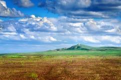 Bogdo mountain under beautiful sky. Panorama of steppe near salt lake Baskunchak Stock Photography