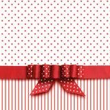 Bogen auf rotem und weißem Hintergrund Stockbilder