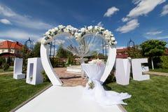 Bogen an der Hochzeitszeremonie Stockfotos
