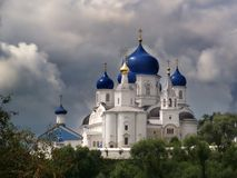 Bogolyubsky monastery. Blue domes of the temple. Russia. Stormy sky, clouds stock images