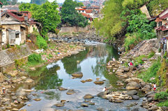 BOGOR, INDONESIA- DECEMBER, 13  2015:  Locals doing domestic activities along the river in Bogor, Indonesia Royalty Free Stock Photo