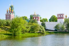 Novodevichy Convent, also Bogoroditse-Smolensky Monastery during the early summer seen from the pond in Moscow , Russia. Royalty Free Stock Photography