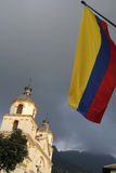 Bogota, Colombia. Colombian Flag and Church Royalty Free Stock Photography
