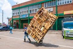 Bogota transport empty wooden boxes Corabastos market royalty free stock photography