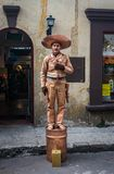 Mexican human statue in the street of Usaquen. BOGOTA, COLOMBIA - MARCH 18, 2018: A man earns his life by making an act of a Mexican human statue in the street royalty free stock photos