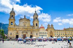 BOGOTA, COLOMBIA OCTOBER 22, 2017: Unidentified people walking in Bolivar square church in a beautiful blue sky in. Bogota, Colombia, Latin America stock photos