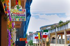 BOGOTA, COLOMBIA OCTOBER 22, 2017: Unidentified people walking in the street 11 with some flags hanging from a building. In a beautiful la Candelaria historic Stock Photos