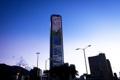 Bogota´s downtown at sunset. View of the Colpatria Tower in Bogotá illuminated with led lights on the sunset time Stock Photos